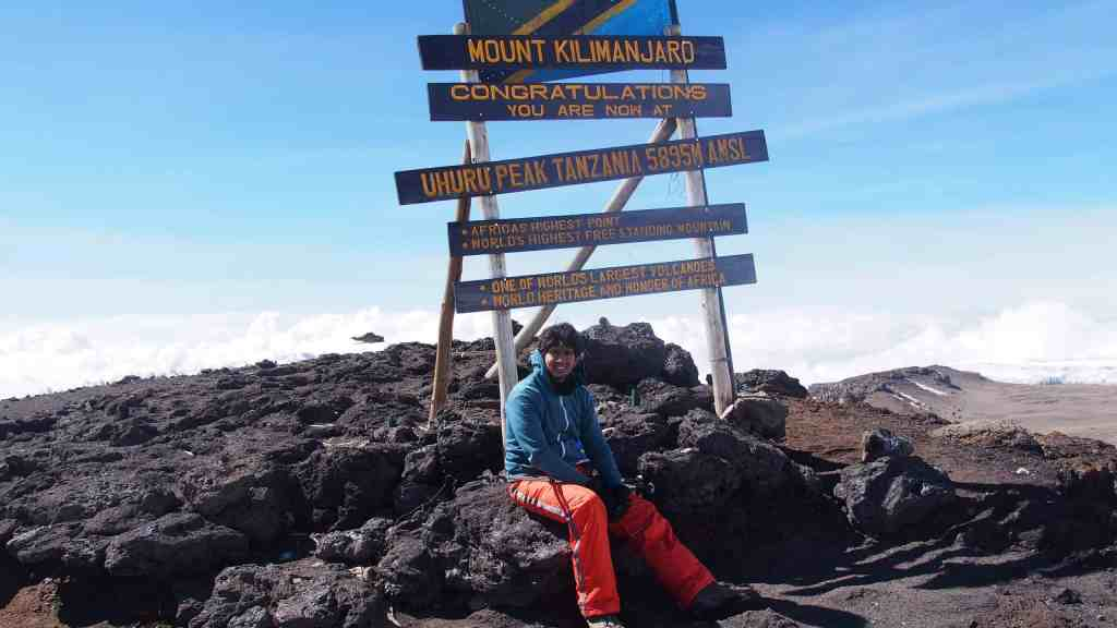 Sitting at the top of Mt Kilimajaro after holding on to an empowering thought and not letting go.