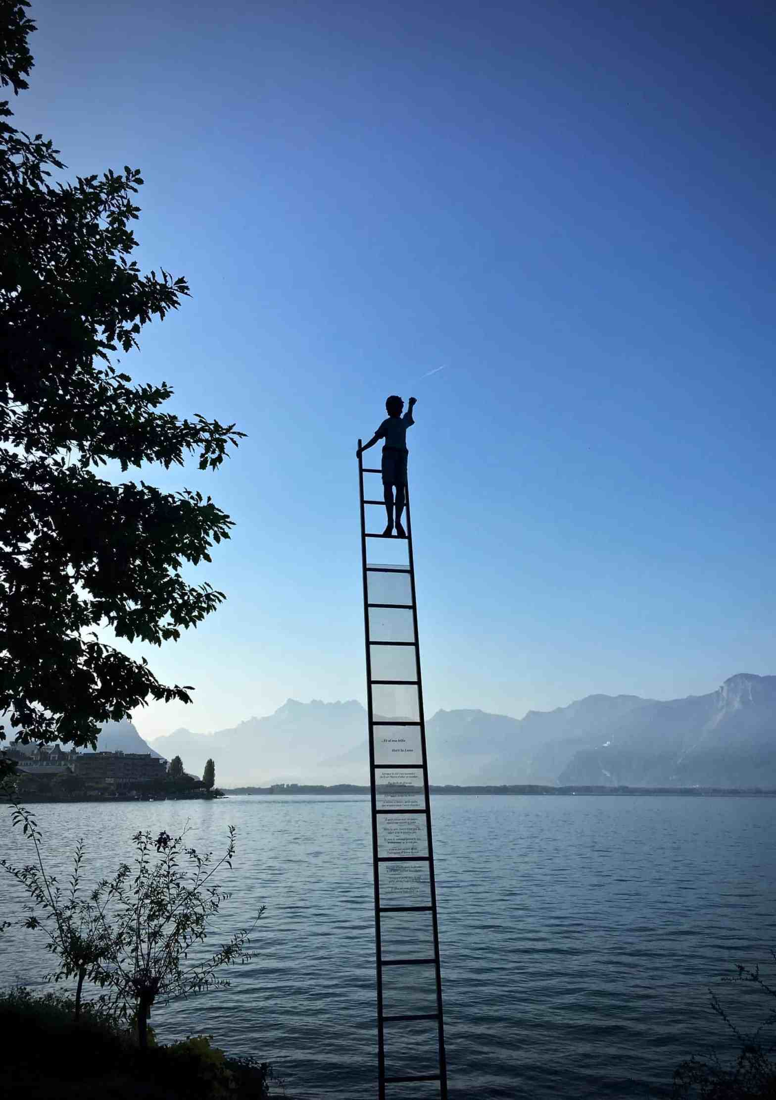 boy-trying-to-touch-the-stars-on-a-ladder-with-ambition