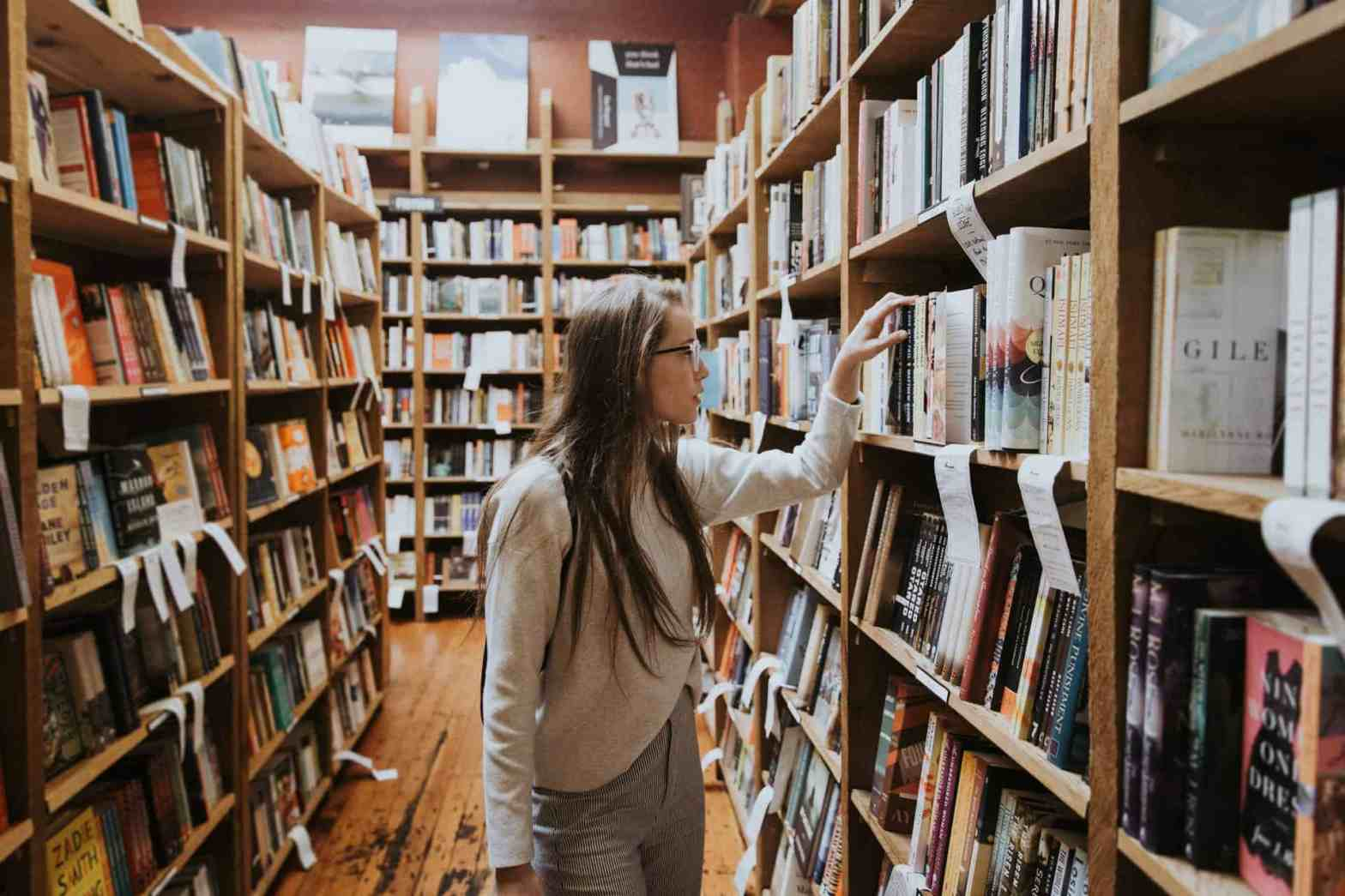 Girl-in-a-library-look-for-books-to-find-purpose-in-life